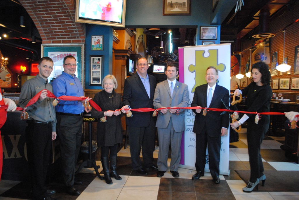 From left, Brandon George, general manager John Zimmer, Chamber president Mo Merhoff, Max & Erma's President Steve Weis, Josh Car, executive board president of Autism Society of Indiana, mayor Jim Brainard and Dana Renay, executive director of Autism Society of Indiana. (Photo by Christian Sorrell)