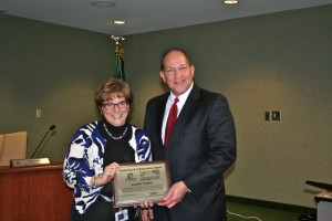 At the Board of School Trustees meeting on Monday night, Dr. Scott Robison recognizes Jennifer Froehle for her efforts in obtaining the RISE grant.(photo by Julie Osborne)