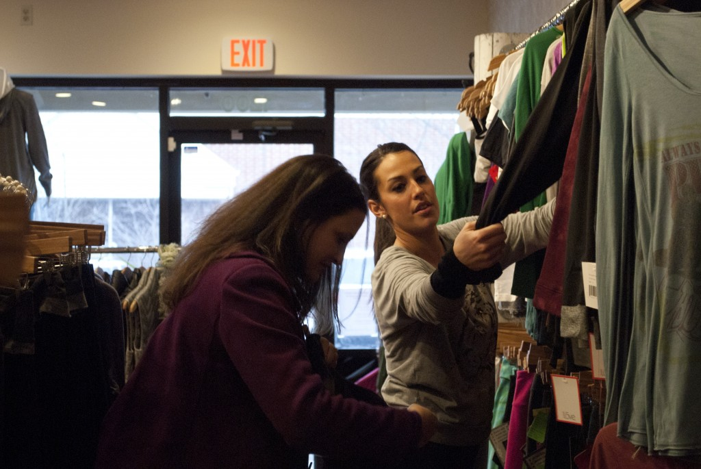 Owner Shelly Petrowski showing a local customer what is new in the store.