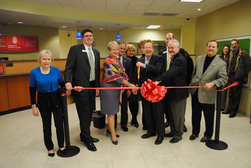 From left, Chamber President Mo Merhoff; Kevin O'Connell, Financial Center manager; Nancy Huber, president and CEO of Central Indiana at Fifth Third Bank; Steve Alonso, head of Consumer Bank; Councilor Luci Snyder; Clerk Treasurer Diana Cordray; Mayor Jim Brainard; Shawn Niehaus, retail executive; Councilor Eric Seidensticker; Councilor Ron Carter.