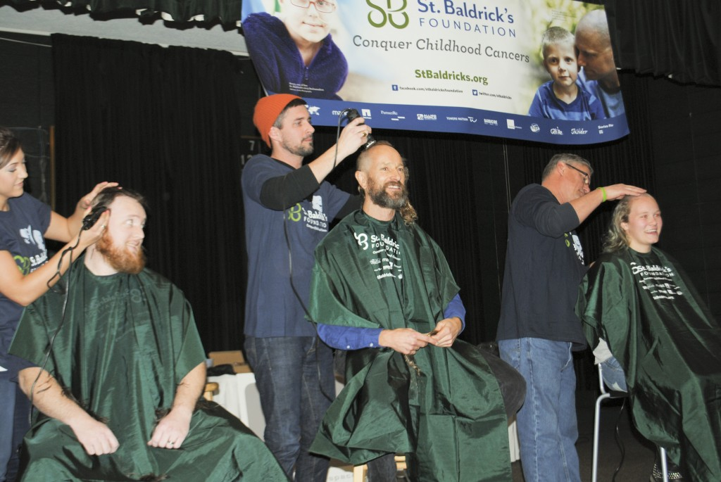 Throughout the event, participants took to the stage to have their head shaved. (Photo by Maddie Scott)