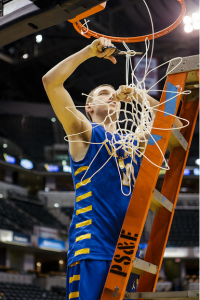 James Crowley cuts down the net.