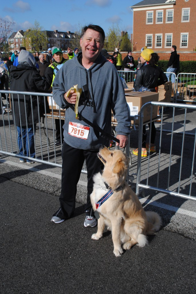 """Mike Ferguson of Fishers ran the Keybank 8k with his dog, Max. """"He loves coming out, getting to run and see everybody,"""" Ferguson said. """"He could probably run it again!"""""""