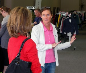 Elizabeth Symmes explains where items are located to a customer.