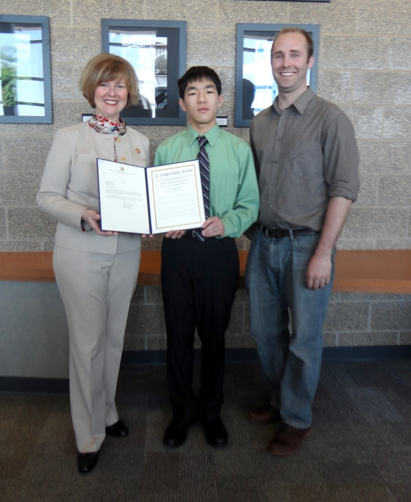 Congresswoman Susan Brooks presents University High School senior Jimmy Wang and his mentor, Derek Thomas, with a copy of the U.S. Congressional Record. The Record recognizes Wang's status as a U.S. Presidential Scholar. (Photo provided by University High School, Carmel)