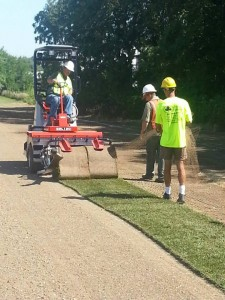 Workers apply the first load of sod earlier this month at Grand Park Sports Campus. The development will feature 26 baseball diamonds, 31 multi-purpose fields for soccer, lacrosse, football, rugby and field hockey and two multi-purpose indoor facilities. (Photo provided)