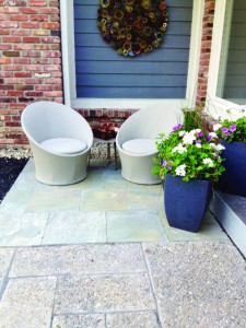 Integrating soft-hued blue stone into existing exposed aggregate helped create a front-yard micro space perfect for relaxing. (Submitted photo)