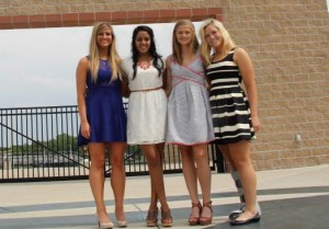 """Rachael Fiege, Srisha Pillay, Annie Weber, and Natalie Estes at graduation. """"Fiege knew how to live life to the fullest and was always making people laugh. I'm so blessed to have been able to call her my friend and teammate,"""" Annie Weber said."""