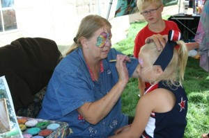 The kids' area will include face painting, bounce houses, and other fun activities.