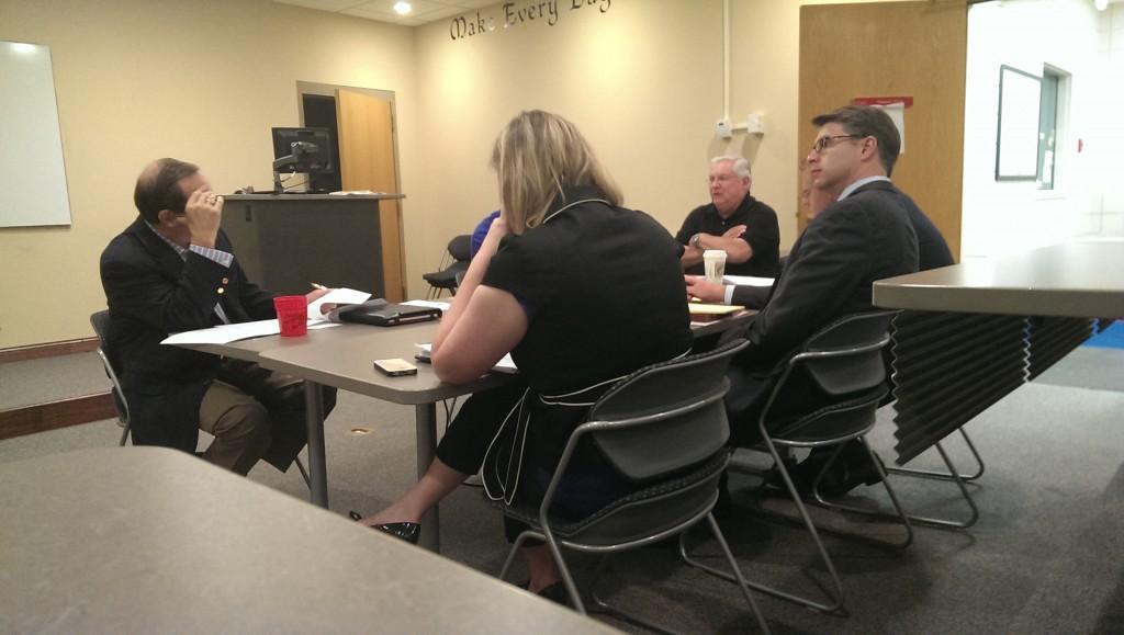 Les Olds, gray hair on right, advises the Carmel City Center Community Development Corp. Sept. 10.