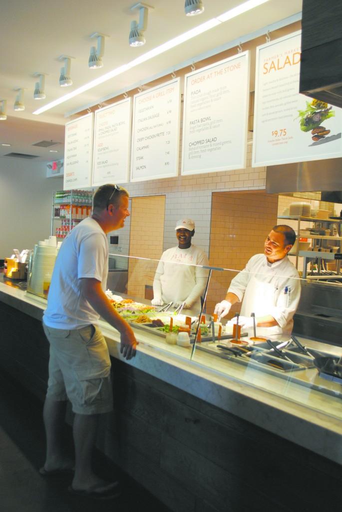 Adam Bollier orders from Piada chef Danny Maffei. (Photo by Karen Kennedy)