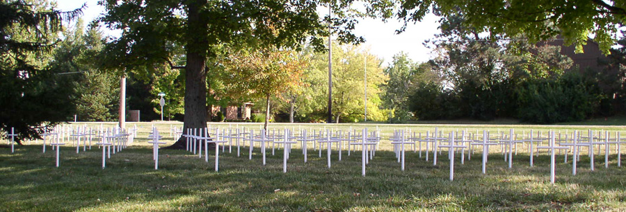 500 white crosses have been erected for The Cemetery of the Innocents on the lawn of St. Alphonsus Catholic Church, 1870 W. Oak St. (Photo by Ward Deglar)