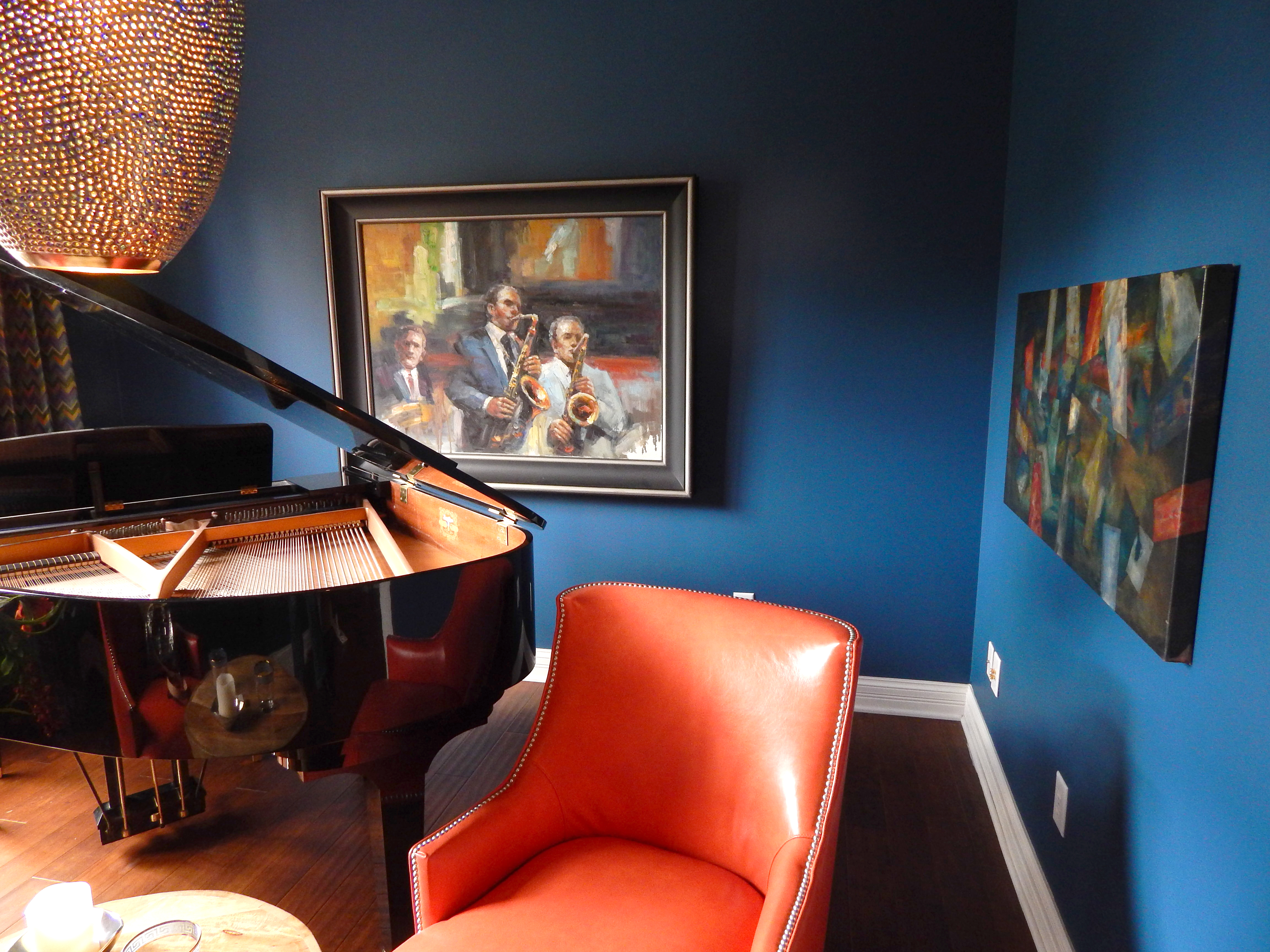 "One of the rooms in the new space is a ""jazz lounge"" which features indigo blue walls and Earley's grand piano.  (Photo by Karen Kennedy)"