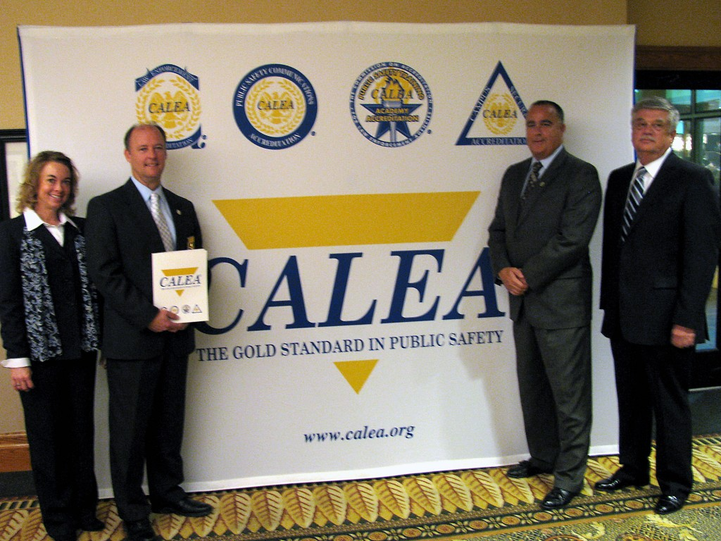 From left: Allison Nicholson, Sheriff Mark Bowen, Major Tom Gehlhausen and Tim Garner receive CALEA re-accreditation at an awards banquet in Winston-Salem, N.C. (Submitted photo)