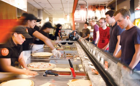 Customers at Blaze Pizza get to see their pizza being made as it moves down an assembly line. (Submitted photo)