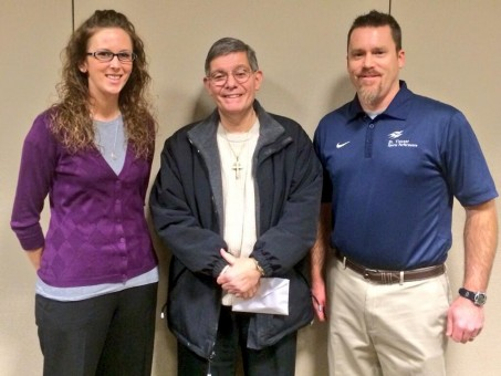 """The school board recognized first responders Todd Arnold, Robert Czarkowski, Maura Flynn, Brittani Ritter and Steve Schofield of St.Vincent Sports Performance for their efforts that saved the life of ref- eree Joe Calderazzo, center, during his collapse at last year's semi-state football game. """"You have no idea how thankful I am,"""" Calderazzo said. """"Thank you so much for saving my life."""" (Submitted photo)"""