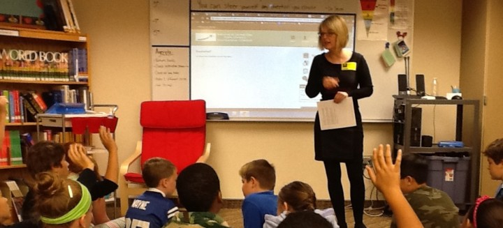 Children's Librarian Holly Southern explains to fifth-grade students at College Wood Elementary School how to access eBooks. (submitted photo)