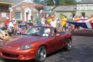 Amy Lacy waves as she rides down Main Street during the Fall Fes- tival Parade. Lacy was named the Grand Marshal of the parade in 2013. (Submitted photo)