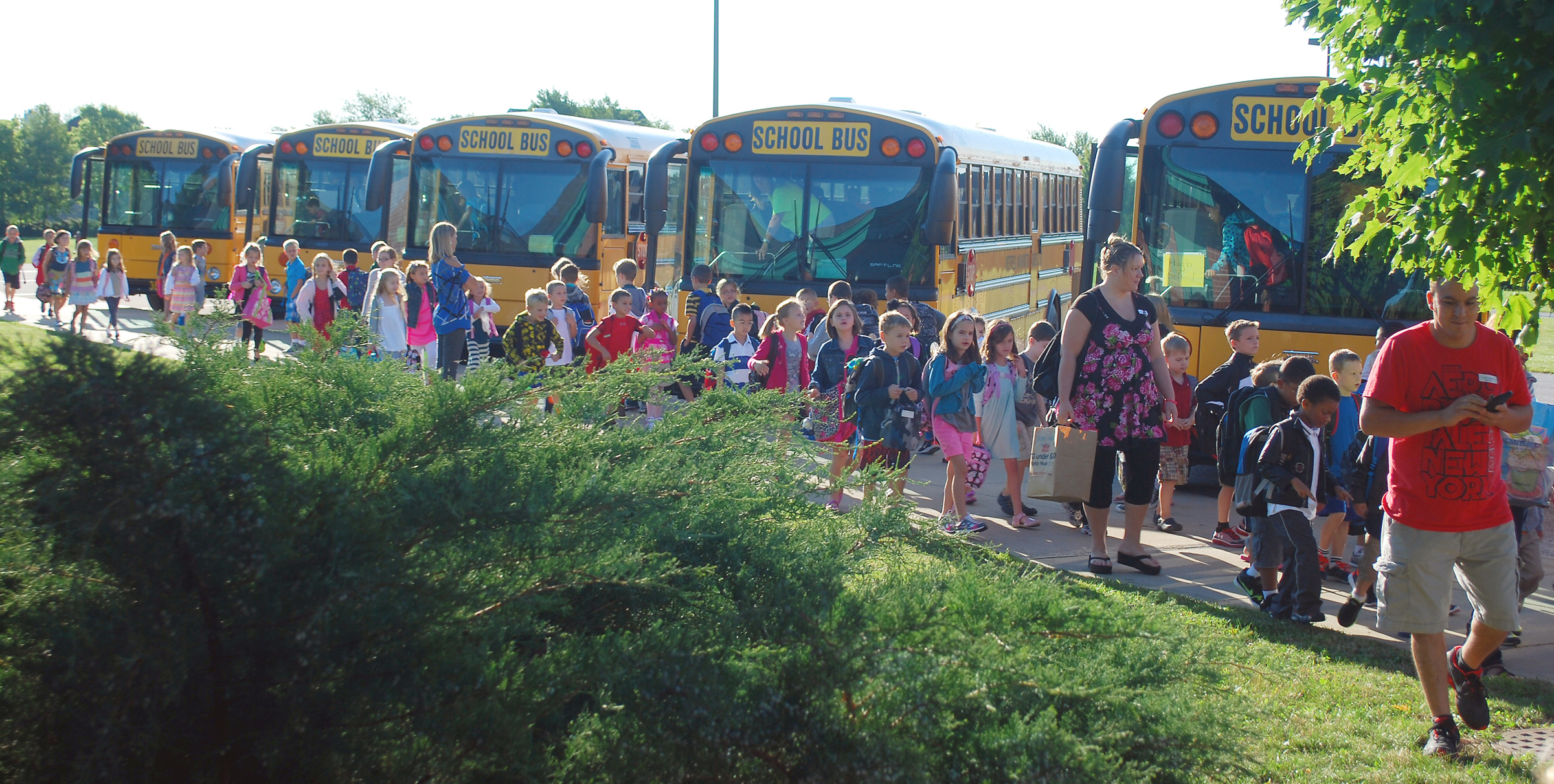 Students exit buses and enter Carey Ridge Elementary on the first day of school last year. (file photo)