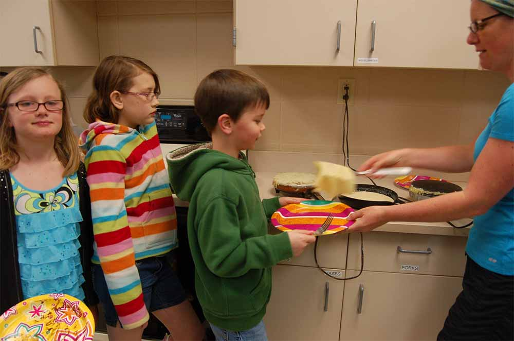 Last year, elementary French students made crepes, or French pancakes, during one of their before-school French lessons. (Submitted photo)