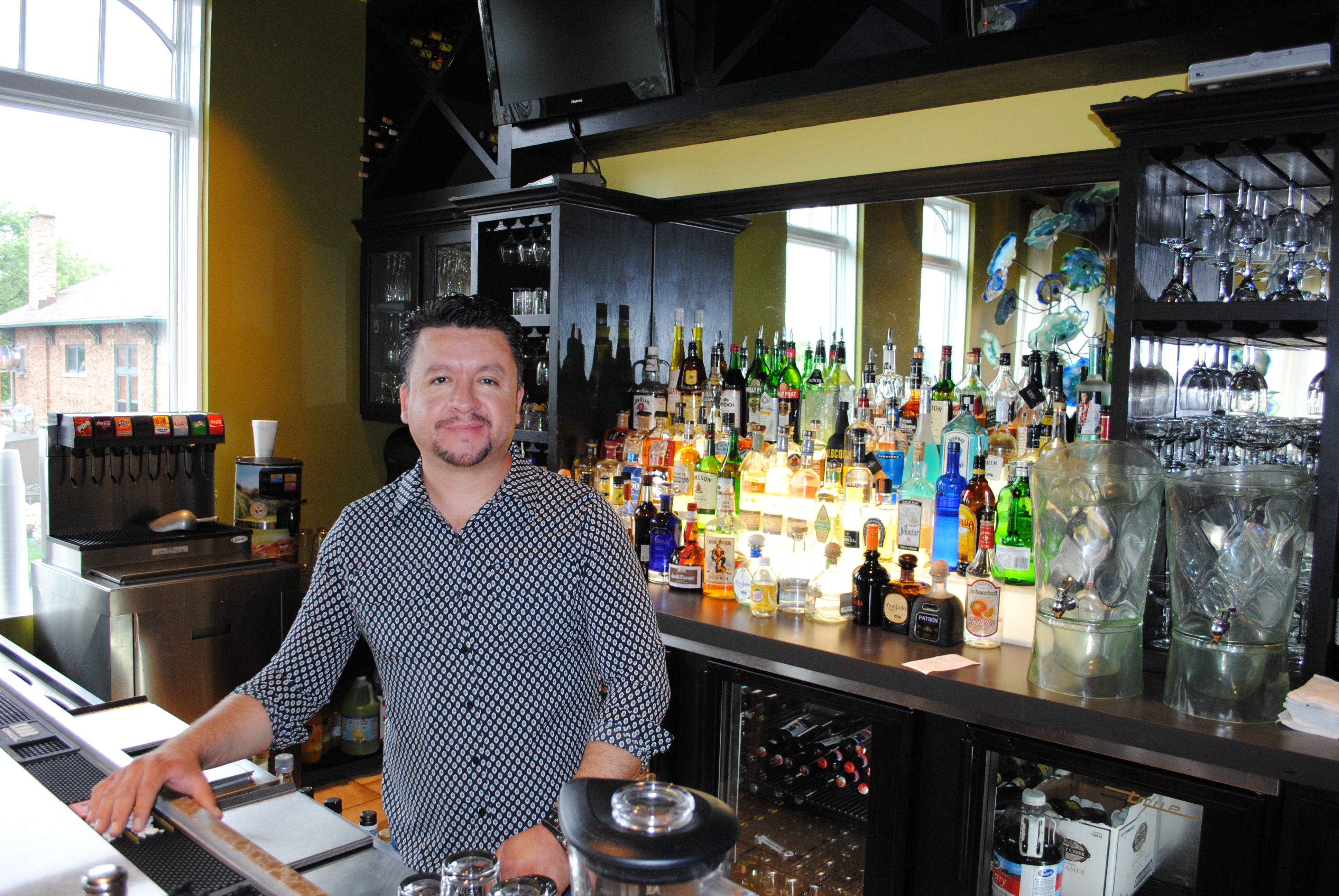 """Owner of Agave, Alejandro Hernadez, says his restaurant is """"all good"""" now. (Photo by Zach Ross)"""