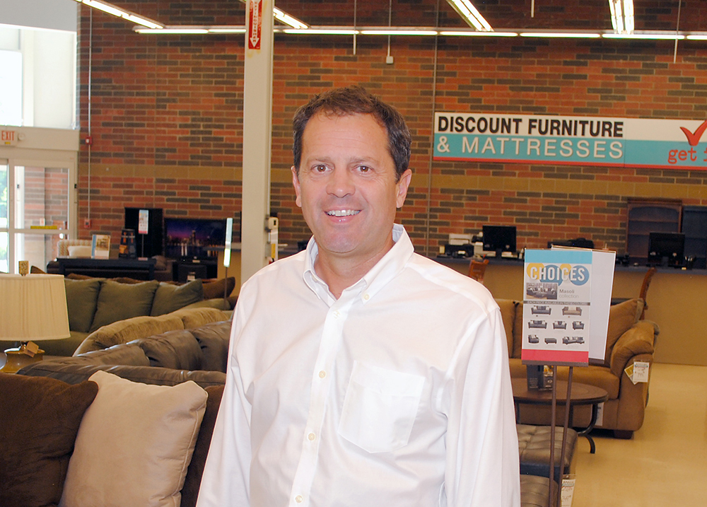 Owner Jeff Godby opened Godby Discount Furniture & Mattress, 130 Logan St., Noblesville, a year after the Westfield clearance store was closed as part of the U.S. 31 expansion. (Photo by Robert Herrington)