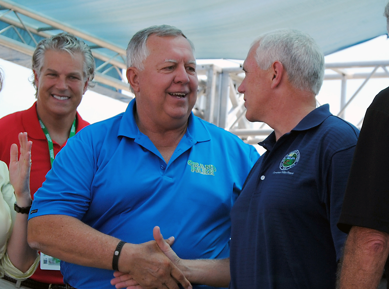 Steve Henke shakes Gov. Mike Pence's hand after the ribbon cutting of Grand Park Sports Complex. Henke Development is the Business of the Year recipient and oversaw the city's massive sports recreation project. (File photo)