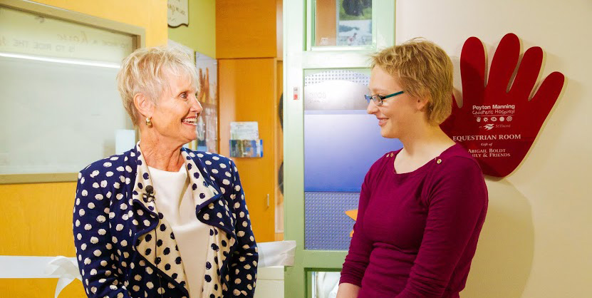 Sue Anne Gilroy congratulates Abigail Boldt on raising the money to create an equestrian-themed pediatric hospital room at St. Vincent's Peyton Manning Children's Hospital. Boldt is a 15-year-old cancer patient from Zionsville undergoing treatment at Peyton Manning Children's Hospital. (Photo by Julie Kennedy)
