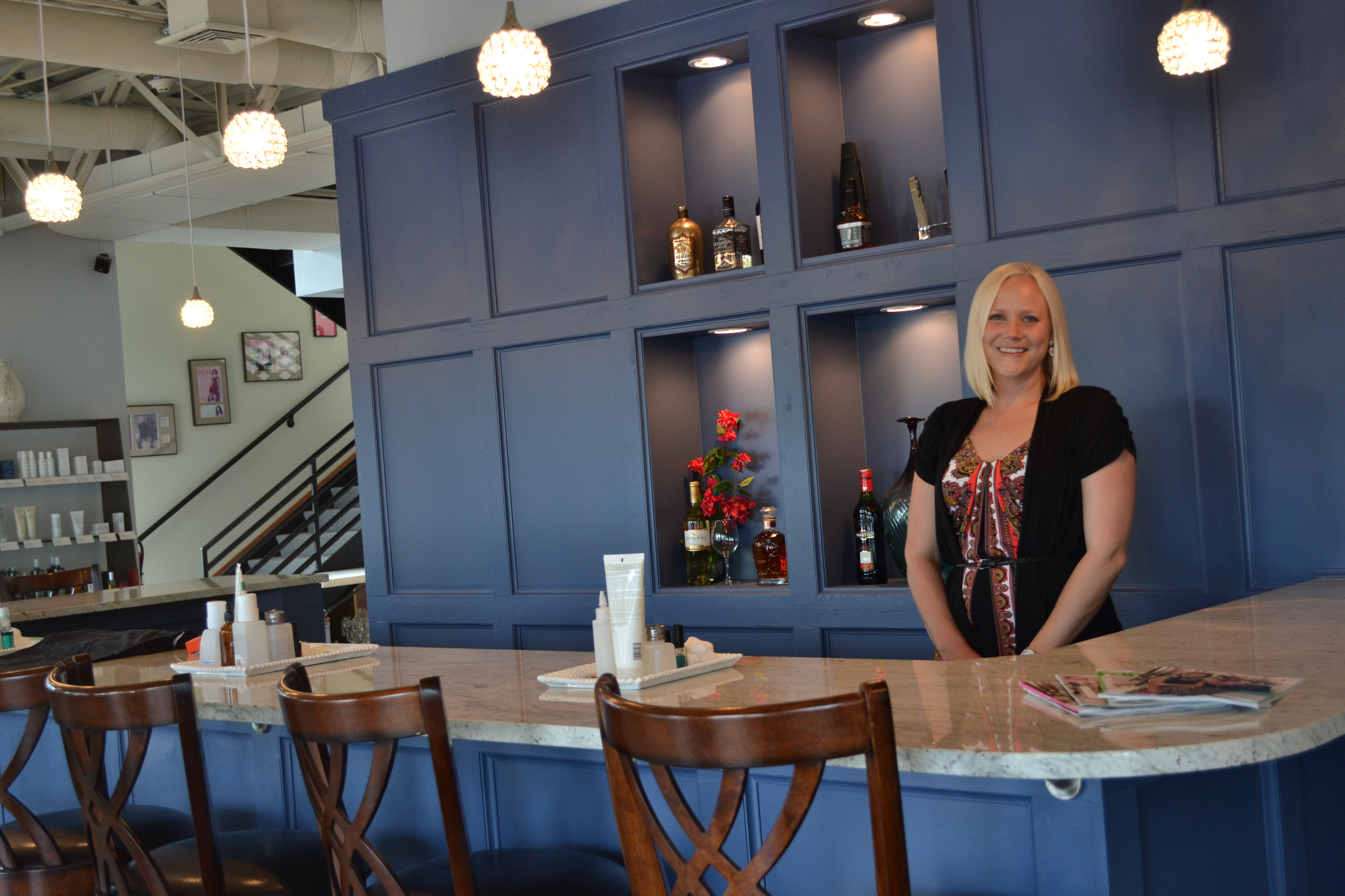 Erin Hunt, owner of Beauty Bar at Geist behind the bar at her new salon. (Photo by Ann Craig-Cinnamon)