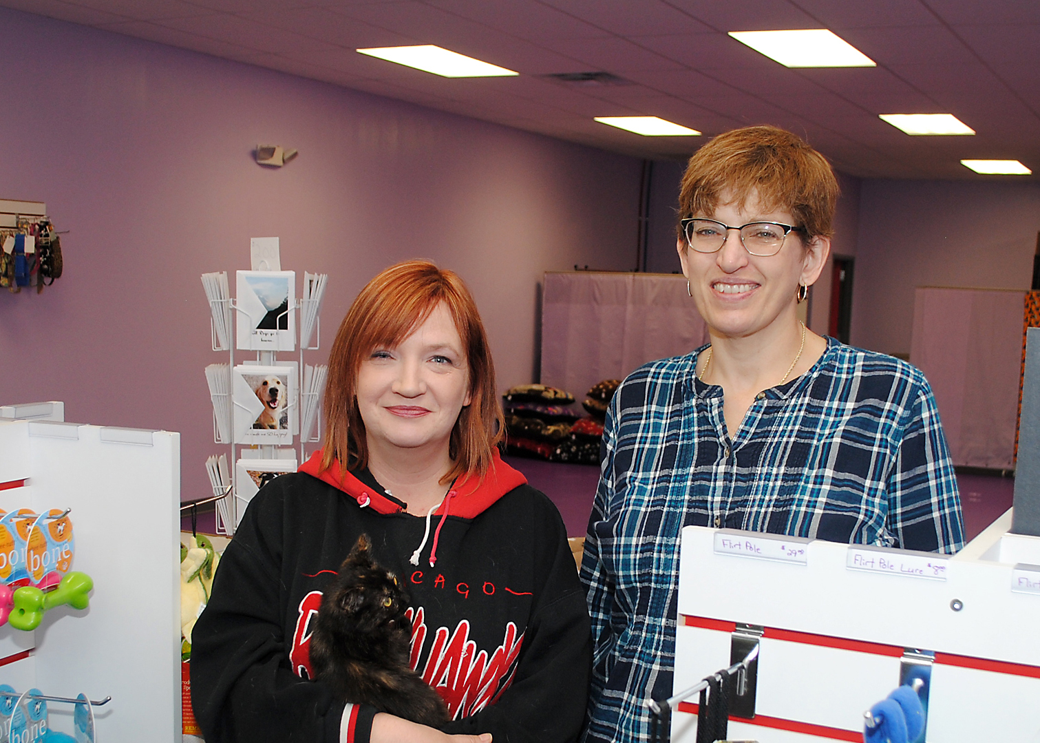 Lori Fricks, left, and Renee Fritz offer dog training, grooming, products and food at their new store Positively Canine, 3276 E. Ind. 32. (Photo by Robert Herrington)