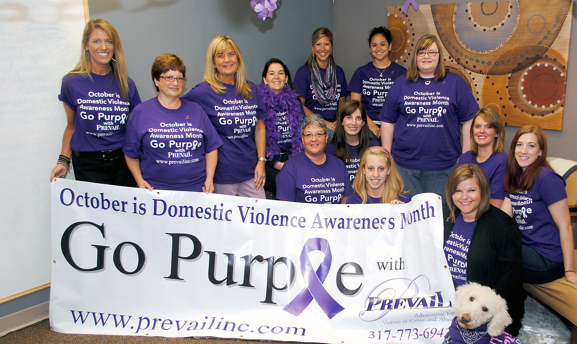 Prevail employees encourage the public to wear purple and learn more about domestic violence for the rest of October. (Photo by Robert Herrington)