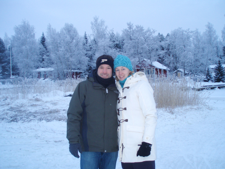 Derek and Petra Sutton stand on the frozen Gulf of Bothnia, which separates Sweden and Finland. In good winters visitors drive across the ice to visit cottages in the background. (Submitted photo)