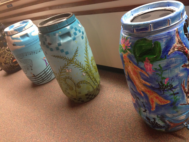Rain barrels were decorated by local artists and will be available for purchase Nov. 8. (Photo by Sophie Pappas)