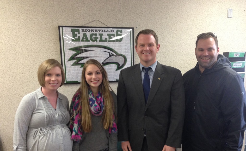 (From left) Teacher Ashley Fox, student Emily Worth, BMO Harris Zionsville manager Geoffrey Sherman, and co-owner of Amore Pizzeria Chris Simone celebrate Fox' Teacher of the Month win. Fox received a $100 cash voucher from BMO Harris as a reward. Worth won a pizza party with Fox and her friends at school. (Photo by Sophie Pappas)
