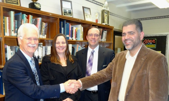 J. Marvin Whitney, Superintendent of Education, and President Van Hurst congratulate Pastor Alex Rodriguez and Kelly Taitano on the Board approval to start a new Adventist school in Carmel.
