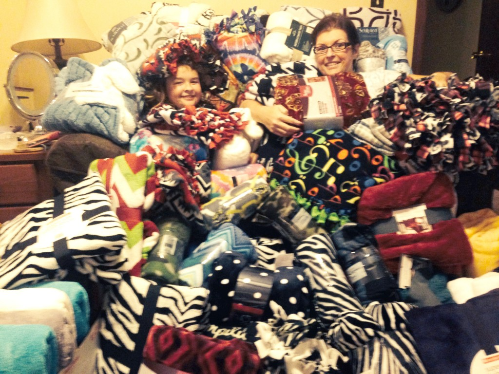 Stephanie Ellis and her daughter with the blankets they received for the cancer center. (Submitted photo)