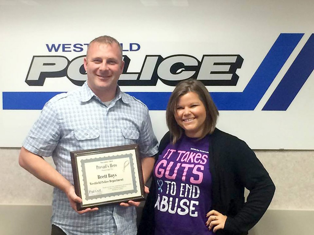 Brittany Winebar, right, presents Westfield police Det. Brett Bays with Prevail's November Hero of the Month recognition. (Submitted photo)