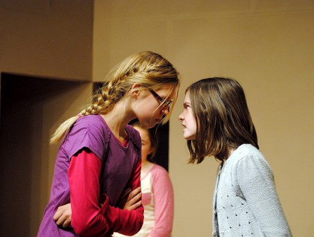 """Beth Bradley (Leah Kerkhoff), left, and Alice Wendlekin (Audrey Duprey) get in a heated argument about the Herdmans behavior in """"The Best Christmas Pageant Ever."""""""