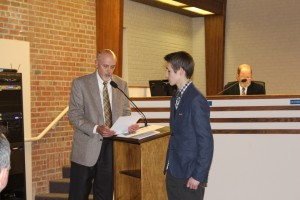 Councilor Steve Mundy acknowledges Weston Clark. (Photo by James Feichtner)
