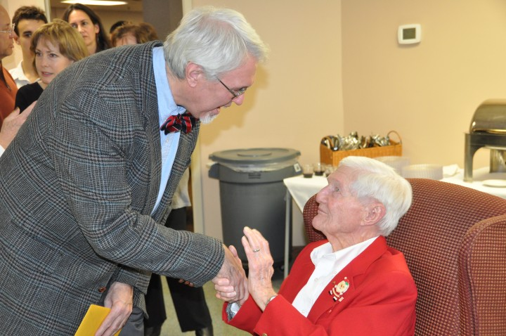 Bowen, seated, greets well-wishers at his birthday party on Dec. 26.