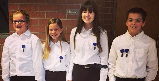 Traders Point fifth graders Julianna Bartels, Alaina Miiller, Rene Hubble and Jackson Wilhite earned first place gold medals in the Instrumental Solo and Ensemble Contest at Avon High School on Jan. 31. (Submitted photo)