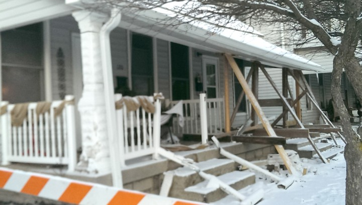 Boards prop up the roofline of a Main Street porch after a car collided into it on Feb. 4. (Photo by Heather Lusk)