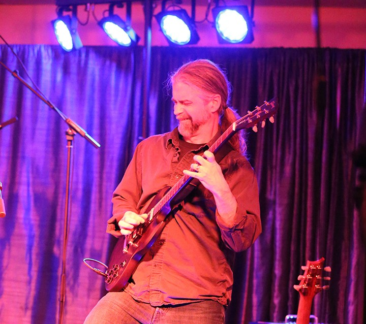 Casey Harshbarger, originally from Zionsville, rocks out on lead guitar for The Warrior Kings during the Legion of Blues show Jan. 31. (Photo by Ann Marie Shambaugh)
