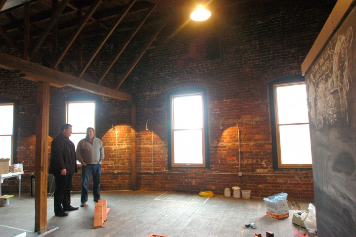 Contractor JR Reynolds and Village Kitchen managing partner Bryan Avery discuss plans for the restaurant. (Photo by Heather Lusk)