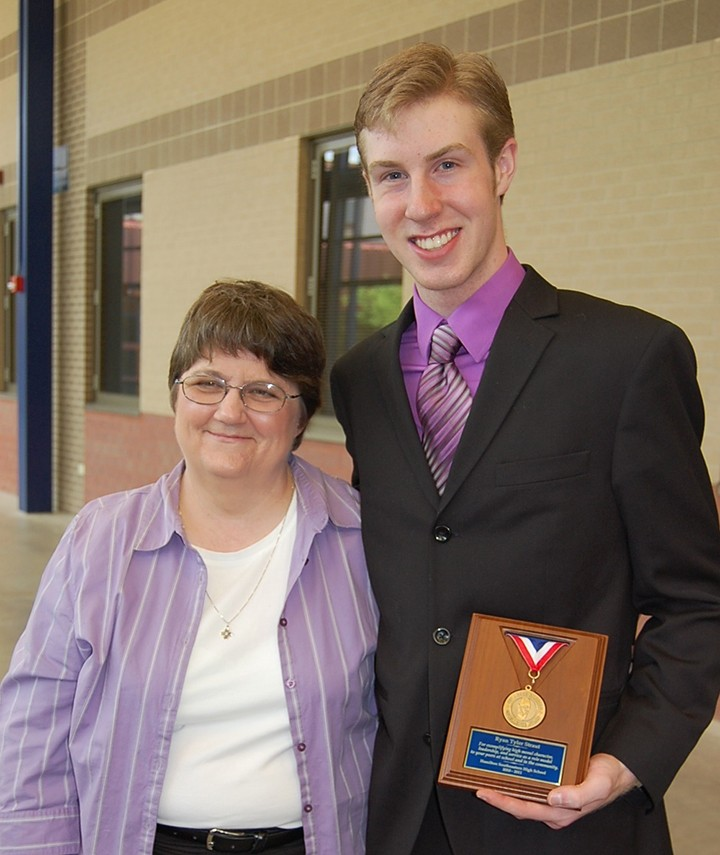 Ryan Straut, a graduate of HSE High School, currently a senior at Purdue University and member of the Purdue Varsity Glee Club, has created a fundraiser to give back to HSE's drama club and choir department. Funds will also support a scholarship for an HSE High School senior. With Straut is Mary Armstrong, sponsor for the drama club. (Submitted photo)