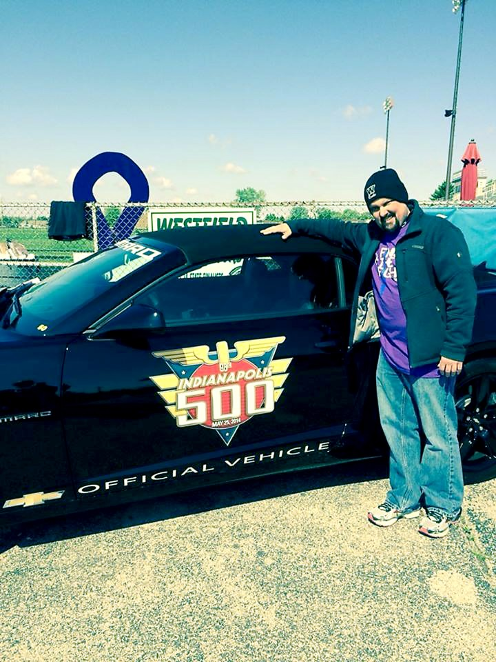Scott Clouse gets his picture taken with the Indianapolis 500 pace car during the Westfield Relay for Life at the football stadium. (Submitted photo)