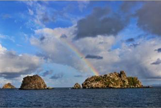 Kayley Adams shot this award-winning photo of a rainbow stretching across the Caribbean Sea from a 46-foot catamaran. (Submitted photo)