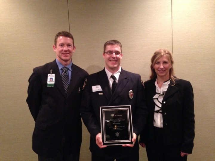 Dr. Mike Kaufmann (left), ZFD medical director, and Sheila Johnson (right), a director at St.Vincent Indianapolis Hospital, present the 2015 St.Vincent Angel Medic Award to ZFD firefighter Justin Spivey. (Submitted photo)