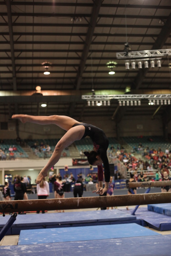 Anna Mariacher competes on beam at the Junior Olympics Level 9 Eastern Championships. She placed fourth in the event. (Submitted photo)
