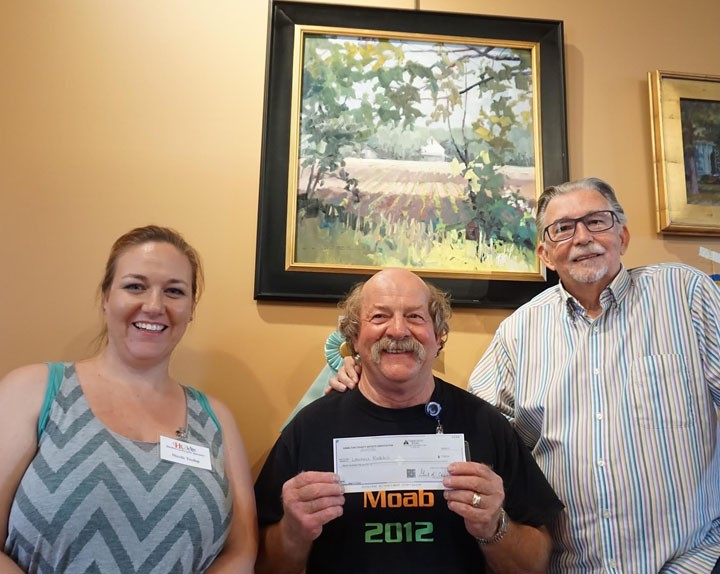 Lawrence Rudeolech, of Madison, Ind., accepts his check from Nicole Tredup (left), event chairmain, and Jerry Points, judge, after winning 'Best of Show' honors in the Hamilton County Artists Association's 7th Annual Gathering of Plein Air Painters on June 6. (Submitted photo)